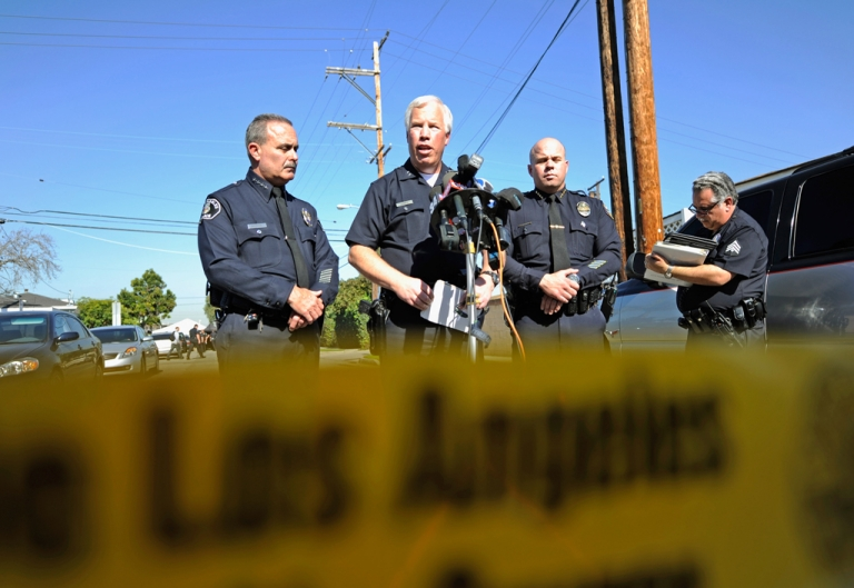 <p>Los Angeles Police Department Deputy Chief Patrick Gannon (2nd L), Los Angeles Unified School District's Steve Zipperman (2nd R) and Gardena Police Chief Ed Medrano (L) hold a news conference. The LAPD and LAUSD district officials are closing Miramonte Elementary School this week to investigate allegations of sexual abuse.</p>