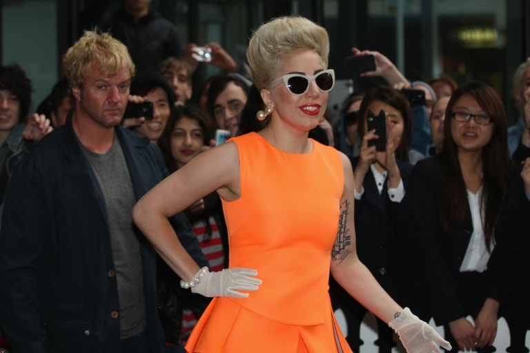 <p>Lady Gaga, greets fans as she arrives at the Stamford Plaza on June 5, 2012 in Auckland, New Zealand</p>
