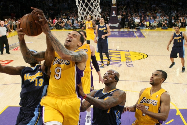 <p>Matt Barnes #9 of the Los Angeles Lakers grabs a rebound against Corey Brewer #13 and Al Harrington #7 of the Denver Nuggets in the first half in Game Five of the Western Conference Quarterfinals in the 2012 NBA Playoffs on May 8, 2012 at Staples Center in Los Angeles, California.</p>