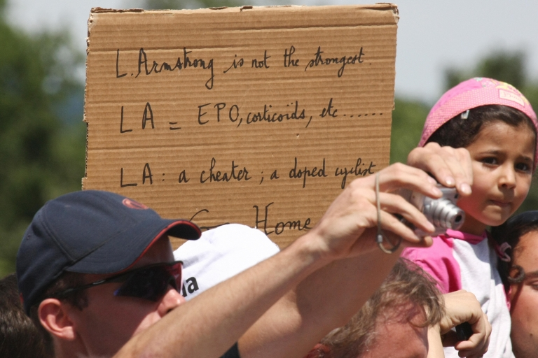 <p>On July 24, 2009, near Bourgoin-Jallieu, France, a fan holds a sign accusing Lance Armstong, seven-time Tour de France winner, of taking performance enhancing drugs.</p>