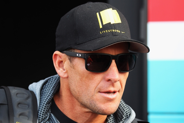 <p>Seven-time Tour de France winner Lance Armstrong attends the Paris Roubaix cycling race on April 8, 2012, in Paris.</p>