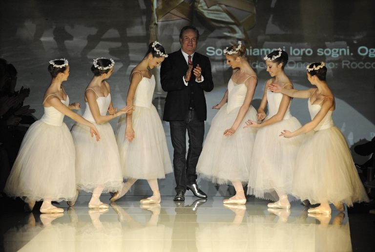 <p>Italian fashion designer Rocco Barocco applauds ballet dancers at a showing of the Roccobarocco Fall/Winter 2009-2010 ready-to-wear collection during Women's fashion week in Milan in 2009.</p>