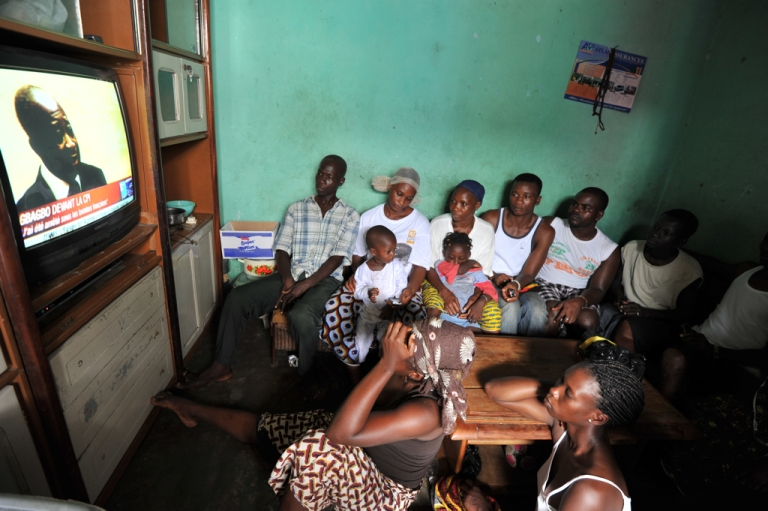 <p>The Dosso family, whose grandmother and five brothers were killed by pro-Gbagbo millitiamen in April, watch a TV broadcast of former Ivorian President Laurent Gbagbo appearing before the International Criminal Court for the first time, on November 5, 2011.</p>