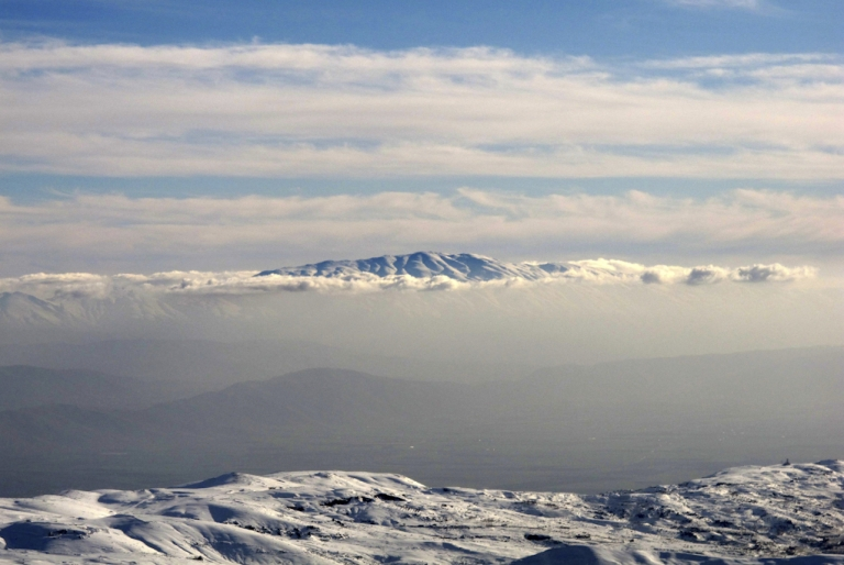 <p>The snow-covered Mount Hermon (Jabal al-Sheikh) which sits on the border between Lebanon, Syria and Israel is seen in the distance from the Kfardebian-Faraya ski resort, northeast of the Lebanese capital Beirut, on January 10, 2012.</p>