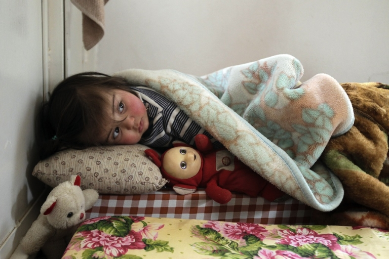 <p>A Syrian girl who fled the violence in Syria sleeps with a doll at a shelter housing refugees in the Lebanese city of Arsal in the Bekaa Valley on March 26, 2012.</p>