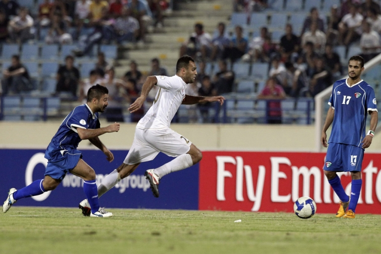 <p>Kuwait's Midfielder Abdulaziz Mashan Al-Enezi (L) fights for the ball with Lebanon's Midlfielder Roda Antar (C) during their 2014 World Cup Asian zone qualifying football match in Beirut, on October 11, 2011. The match ended in a 2-2 draw. AFP PHOTO /JOSEPH EID</p>