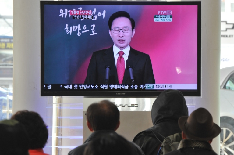 <p>South Koreans listen to a televised address by President Lee Myung-Bak in Seoul, Jan. 2, 2012.</p>