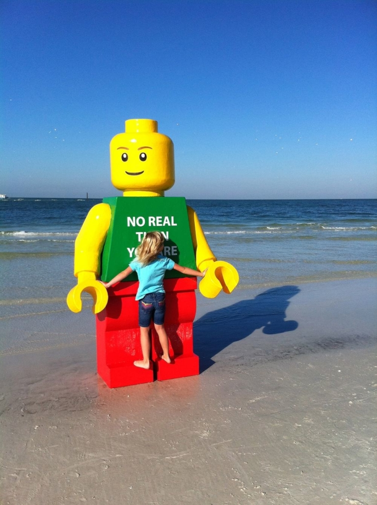 <p>Beachgoers snapped photos and shot videos of the larger-than-life Lego man that washed up on Sarasota's Siesta Key beach.</p>