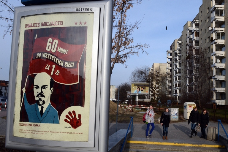 <p>An advertising poster by one of Polish mobile operators featuring a caricature of former Soviet leader Vladimir Lenin is pictured in Warsaw on January 8, 2013.</p>