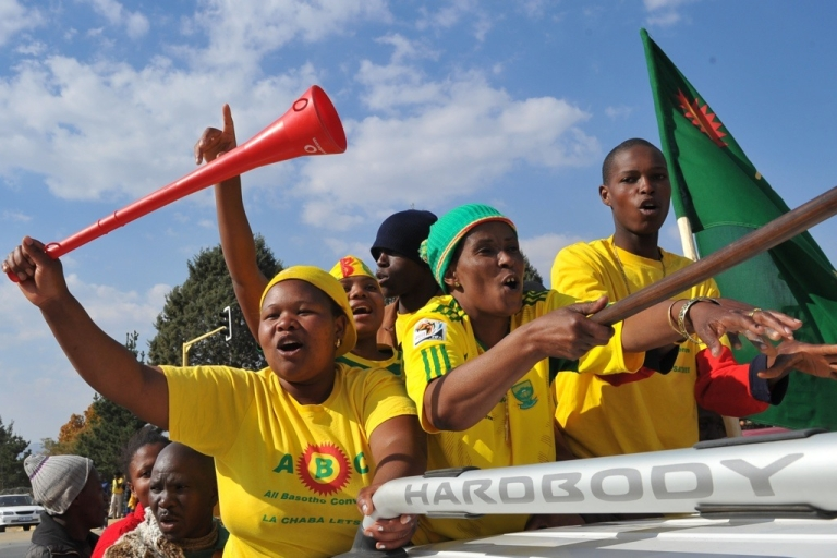<p>Supporters of Thomas Thabane, leader of the All Basotho Convention (ABC) party, celebrate in Maseru. Thabane is expected to become the tiny country's new prime minister. Voting took place smoothly across the kingdom where most people live as farmers in villages separated by towering mountain ranges, which many crossed by foot to reach their polling stations.</p>