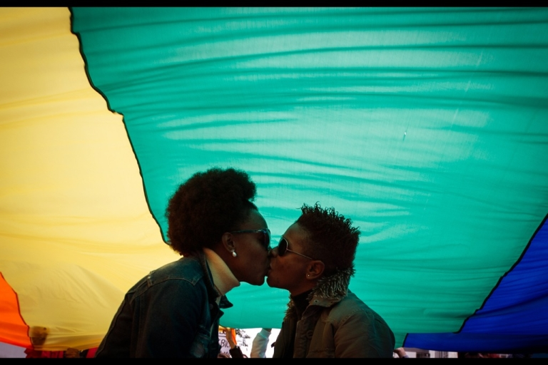 <p>A couple kiss under the rainbow flag during the 10th lesbian and bisexual parade to protest against injustice and to promote the fight for their rights, on June 9, 2012, in Sao Paulo, Brazil, on the eve of the LGBT pride parade.</p>