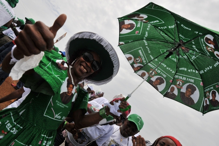 <p>Supporters of Liberia's President Ellen Johnson Sirleaf, winner of the 2011 Nobel Peace Prize and presidential candidate, cheer on a street of Monrovia on October 9, 2011. On Oct. 11 Liberia holds its second election since the end of successive civil wars between 1989 and 2003. Since 2006, Liberia has been led by Johnson Sirleaf, Africa's first elected woman president.</p>