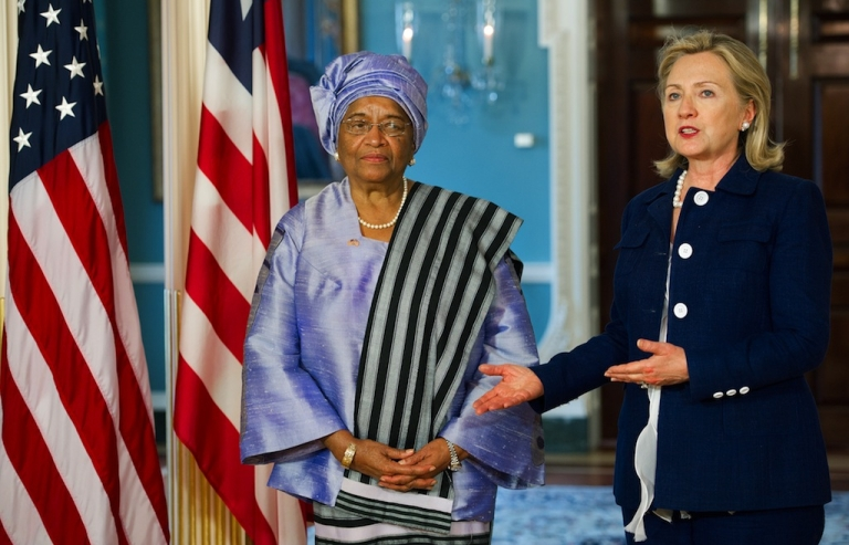 <p>US Secretary Clinton (R) and Liberian President Ellen Johnson Sirleaf speak to the press after a private bilateral meeting at the Department of State. June 23, 2011, in Washington, DC.</p>