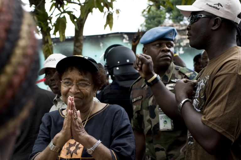 <p>Liberian President Ellen Johnson Sirleaf says she hopes for a peaceful outcome in Liberia's runoff election on November 8. She spoke to a crowd of supporters on October 15, 2011 outside offices of her party on the outskirts of Monrovia that had been set alight overnight in a suspected arson attack.</p>