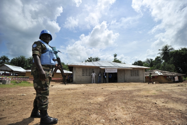 <p>A UN peacekeeper patrols as Liberian incumbent President Ellen Johnson-Sirleaf casts her ballot in her hometown on Nov. 8, 2011.  Early voting was slow in the tense capital following Monday's violence, in marked contrast to long lines that greeted the opening of the polls in last month's first round.</p>