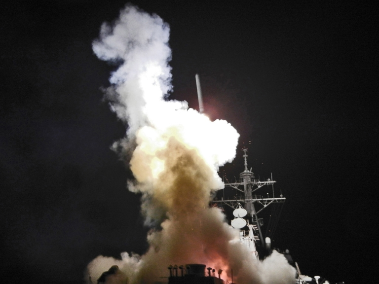 <p>The USS Barry launches a Tomahawk missile in support of Operation Odyssey Dawn, March 19, 2011. This was one of approximately 110 cruise missiles fired from U.S. and British ships and submarines targeting about 20 sites along Libya's Mediterranean coast.</p>