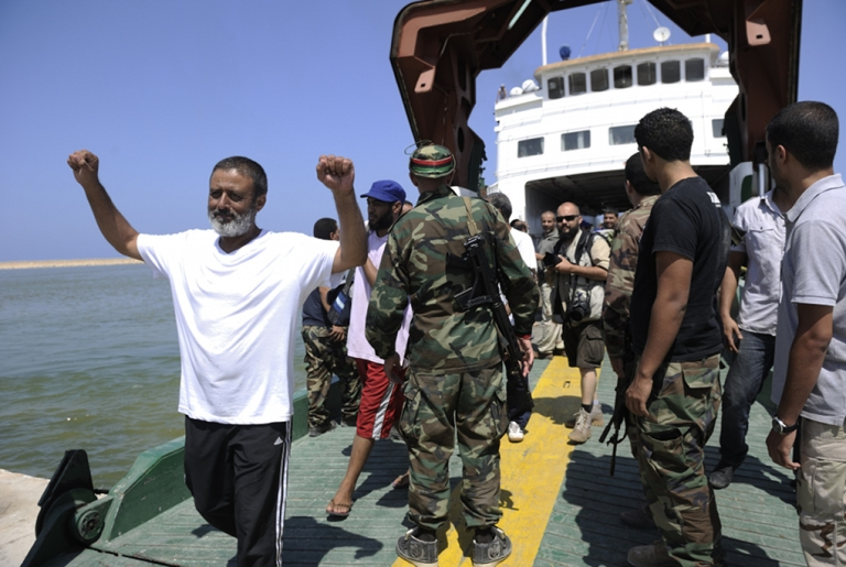 <p>People evacuated from the Libyan capital arrive in the port of Benghazi aboard a ship chartered by the International Organization for Migration (IOM) on August 27, 2011. The ship carryied 263 evacuees, including Libyan political prisoners who had been freed.</p>