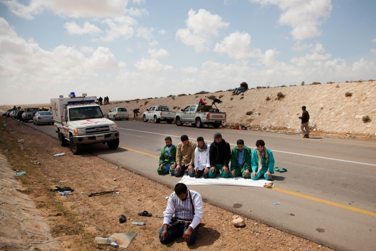<p>A medical team pauses from prayer on the front lines of the battle for Brega.</p>