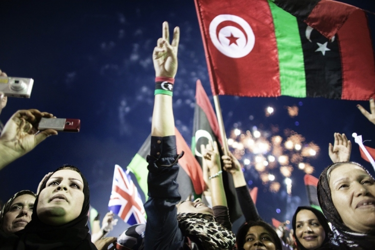 <p>Libyans celebrate the announcement of the liberation of the country in Martyr's Square in central Tripoli on October 23, 2011, three days after ousted leader Muammar Gaddafi was captured and killed.</p>
