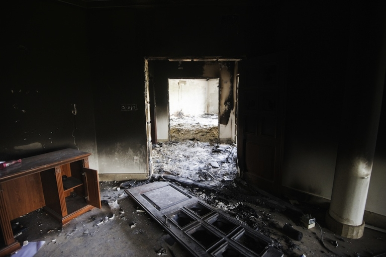 <p>A picture shows damage inside the burnt US consulate building in Benghazi on September 13, 2012, following an attack on the building late on September 11 in which the US ambassador to Libya and three other US nationals were killed. Libya said it has made arrests and opened a probe into the attack, amid speculation that Al Qaeda rather than a frenzied mob was to blame.</p>
