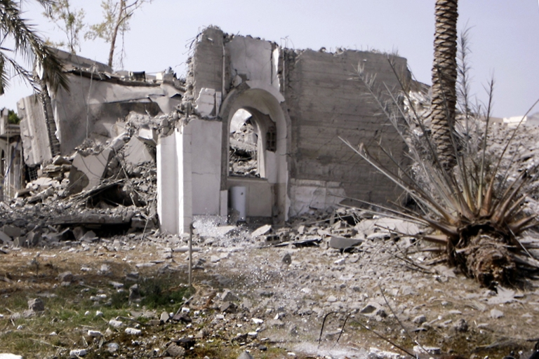 <p>A picture shows a destroyed building at the Bab Al-Aziziya district where veteran leader Moamer Kadhafi has his base, in Tripoli on June 7, 2011 as NATO warplanes pounded the Libyan capital.</p>