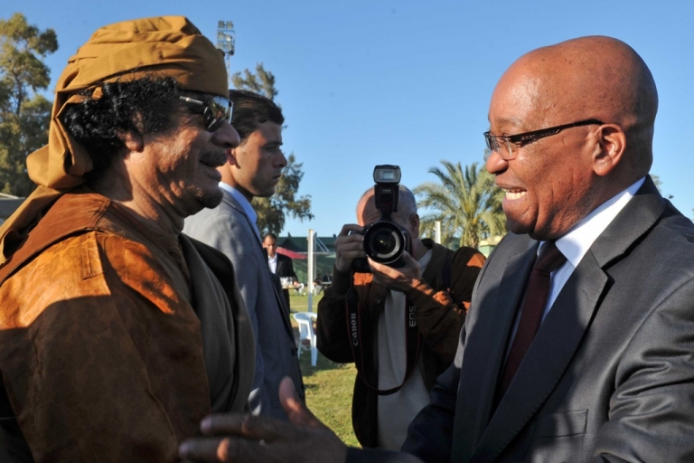 <p>South Africa and the African Union have remained loyal to longtime friend and ally, the Libyan leader Muammar Gaddafi. Here South African President Jacob Zuma shakes hands with Gaddafi on his arrival in Tripoli, Libya on April 10, 2011.</p>