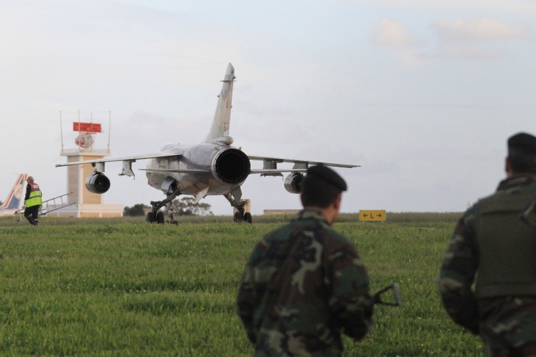 <p>A Libyan air force F1 mirage sits on the tarmac of Malta airport after landing on Feb. 21, 2011. Two Libyan fighter jets and two civilian helicopters carrying seven people who told immigration police they were French landed in Malta on Monday, Maltese military sources told Agence France-Presse.</p>