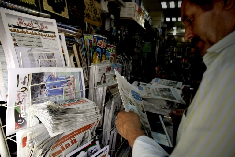 <p>A Libyan man buys a newspaper from a newstand in Tripoli on Nov. 15, 2011. Media outlets are witnessing a huge expansion in Libya after the country's revolution.</p>