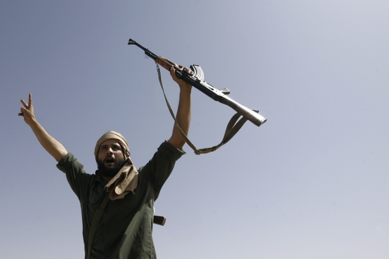 <p>A Libyan rebel flashes the V-sign for victory on Sept. 25, 2011 outside of Bani Walid, Libya.</p>