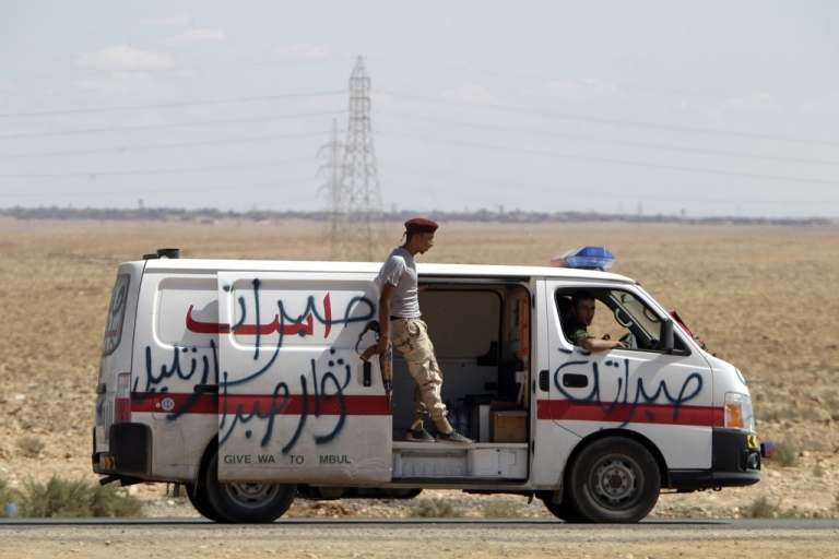 <p>A rebel ambulance arrives at the front lines of the conflict in Libya on Sept. 23, 2011.</p>
