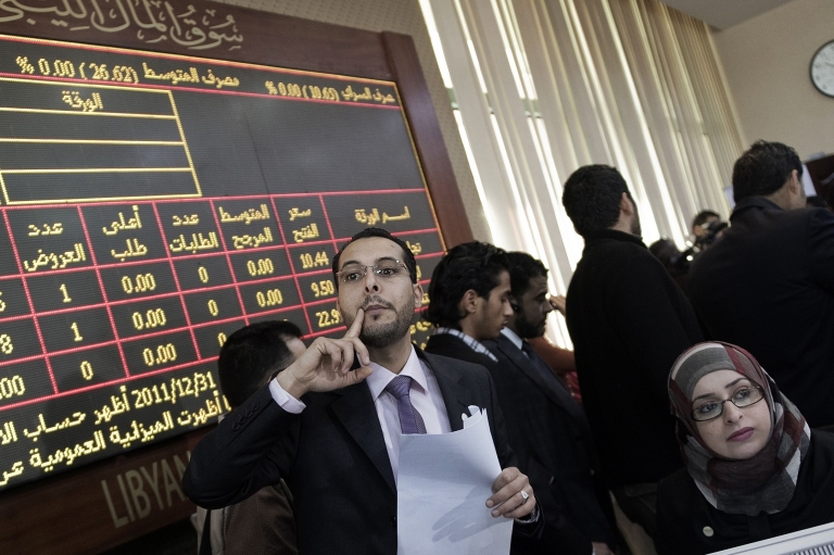<p>Brokers busy at work during the official reopening of the Libyan stock market in the capital Tripoli on March 15, 2012.</p>