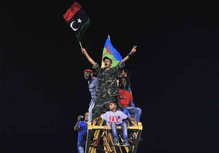 <p>Libyans celebrate on top of a crane in Martyrs Square (formerly Green Square under Gaddafi) in Tripoli, Libya on August 30, 2011. Thousands of Libyans gathered in the square to celebrate the success of rebel fighters against Gaddafi's forces and the beginning of the Muslim festival Eid.</p>