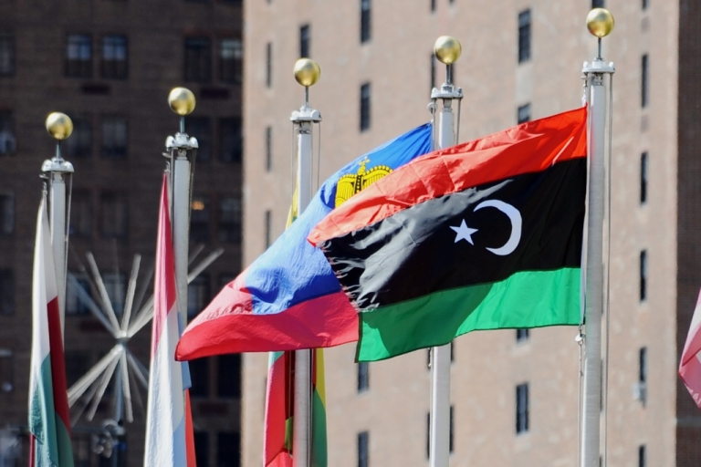 <p>The flag of Libya's National Transitional Council flies outside United Nations headquarters September 19, 2011 in New York.</p>