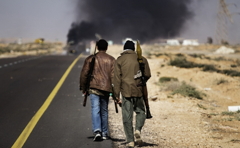 <p>Smoke billows from the fighting in Sidra, 10 kilometres (six miles) west of Ras Lanuf, on March 10, 2011,</p>