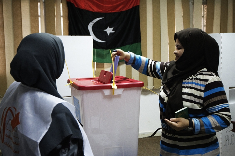 <p>A Libyan woman casts her ballot at a polling station in Tripoli on July 7, 2012 as voters headed to the polls to elect Libya's General National Assembly.</p>
