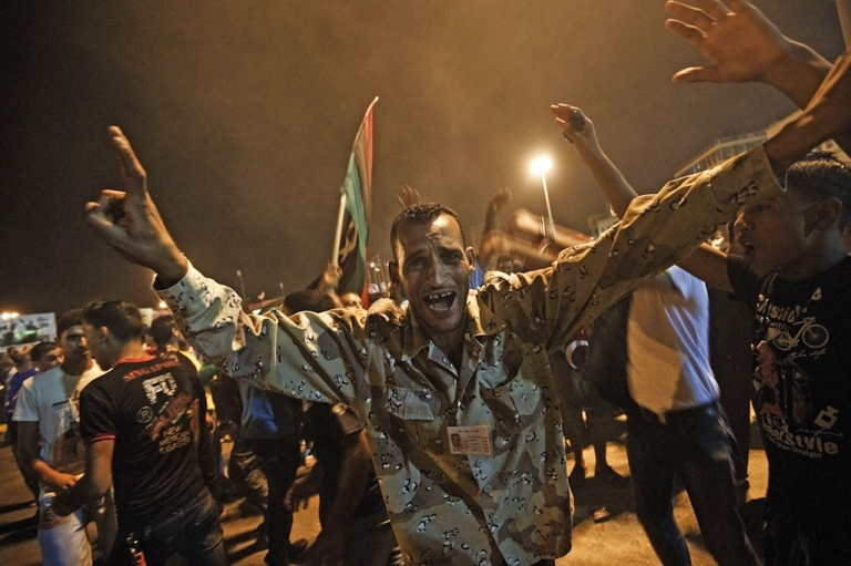 <p>Tens of thousands of Libyans celebrate the arrest of Muammar Gaddafi's son Saif al-islam and the partial fall of Tripoli in the hands of the Libyan rebels on August 21, 2011, in Benghazi, Libya.</p>