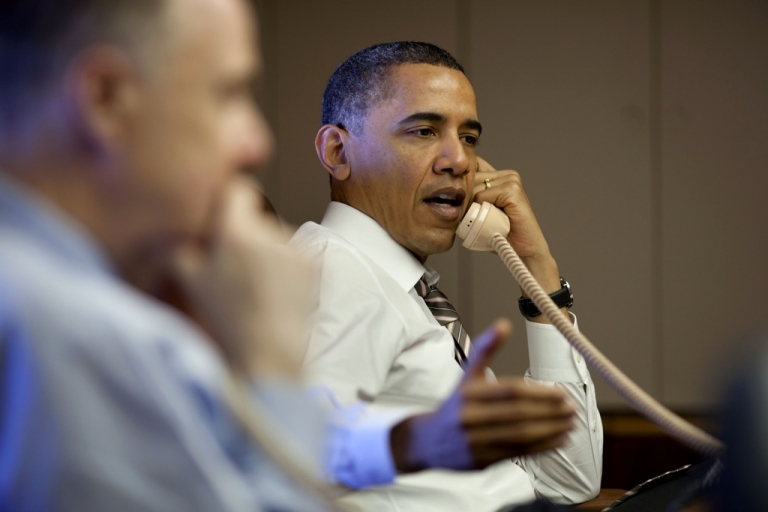 <p>President Barack Obama leads a briefing on Libya by National Security Advisor Tom Donilon, (L) and Chief-of-Staff Bill Daley, during a secure conference call aboard Air Force One in flight from Rio de Janeiro, Brazil to Santiago, Chile on March 21, 2011.</p>