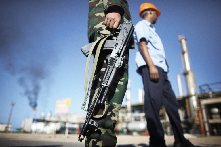 <p>Security concerns remain for Libya's oil sector. Here, the new government's security forces protect the Zawiya Oil Refinery, some 40 kms west of Tripoli.</p>