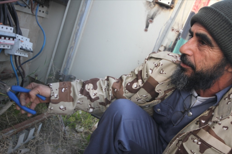 <p>Shoihdi repairs a broken power circuit in Misrata last week. A devoted family man and electrician, Shoihdi remains a member of his militia group and is on call to respond to security issues with his unit.</p>