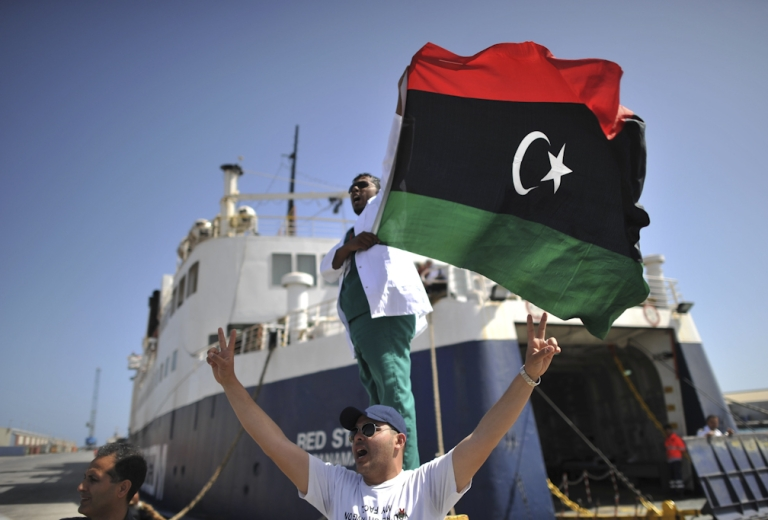 <p>Libyan medic celebrates as they arrive in the port of Misurata after days of waiting out at sea on May 4, 2011, to evacuate civilians and wounded from this restive city being pounded by Libyan leader Muammar Gaddafi's forces.</p>