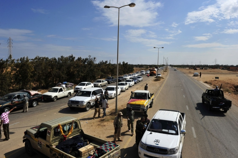 <p>Evacuees from Muammar al-Gaddafi's hometown of Sirte line up their cars while waiting to cross a check point between Sirte and Misrata on October 04, 2011.</p>