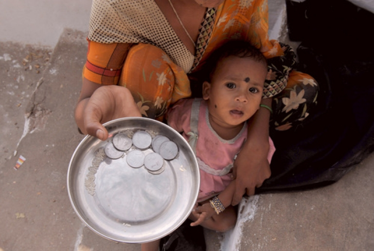 <p>Lowering the bar: India reduced its legion of poor by 7 percent, according to new statistics. Of course, the economic planners did reduce the poverty line from an already contoversial 32 rupees to 28 rupees per day ($0.64 to $0.56).</p>