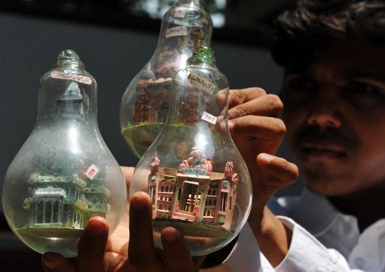 <p>New use for an old favorite? Indian artist Vijay Kumar B Pawar shows artwork inside light bulbs in Bangalore on April 16, 2010.</p>