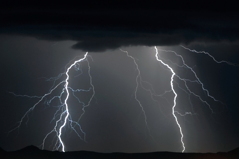 <p>Lightning flashes east of Las Vegas during a thunderstorm on Sept. 13, 2011.</p>