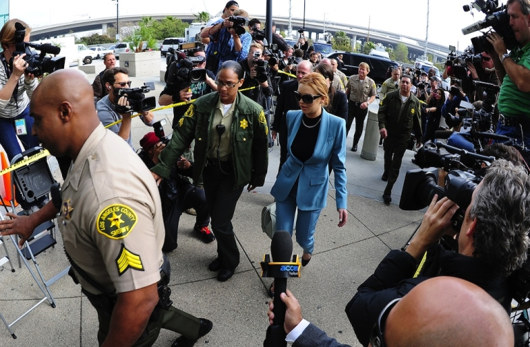 <p>Actress Lindsay Lohan arrives for a probation progress report hearing at Superior Court in Los Angeles on March 29, 2012. The troubled starlet is never far from a scandal.</p>