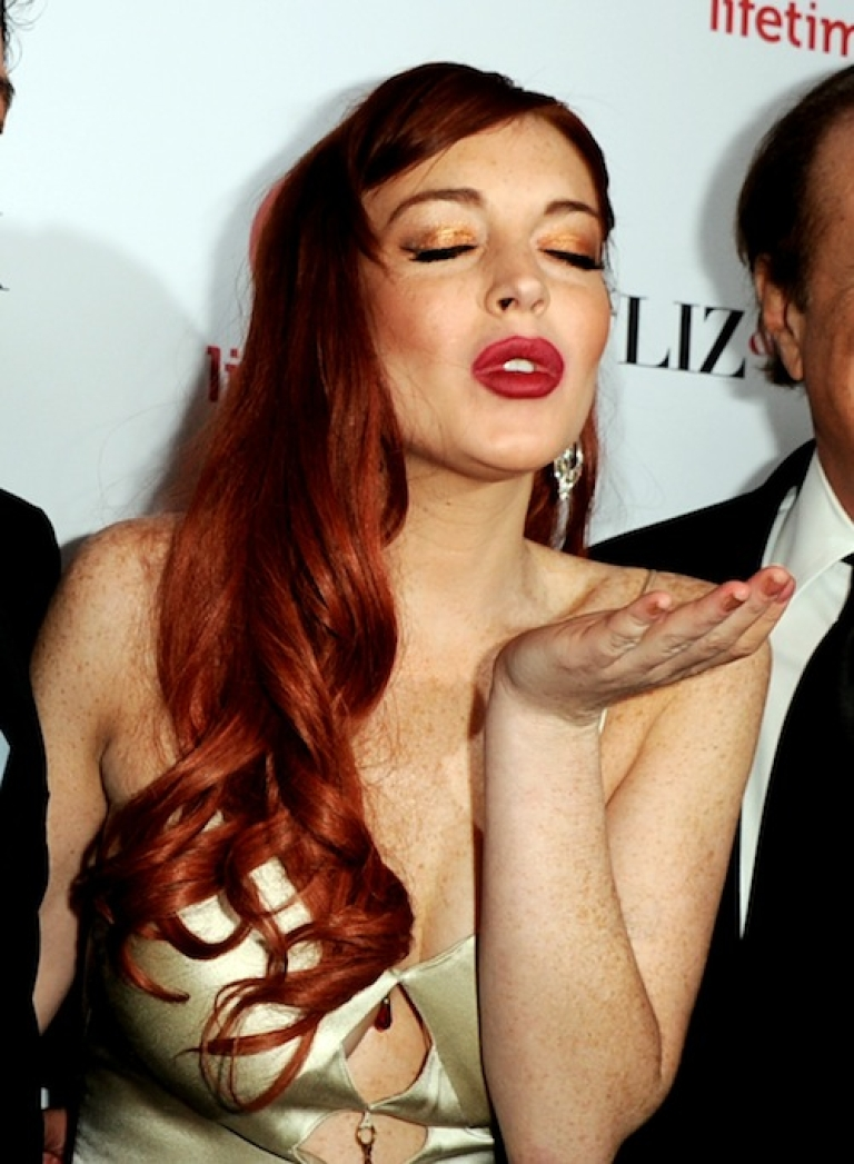 <p>BEVERLY HILLS, CA - NOVEMBER 20: Actress Lindsay Lohan arrives at a party to celebrate Lifetime's 'Liz &amp; Dick' at the Beverly Hills Hotel on November 20, 2012 in Beverly Hills, California.</p>
