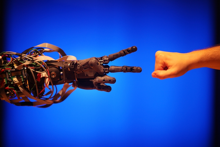 <p>A Science Museum employee plays a game of 'paper scissors stone' with BERTI the robot at The Science Museum's Antenna Gallery in London. Feb. 17, 2009. BERTI is a life size humanoid robot built to mimic human gestures.</p>