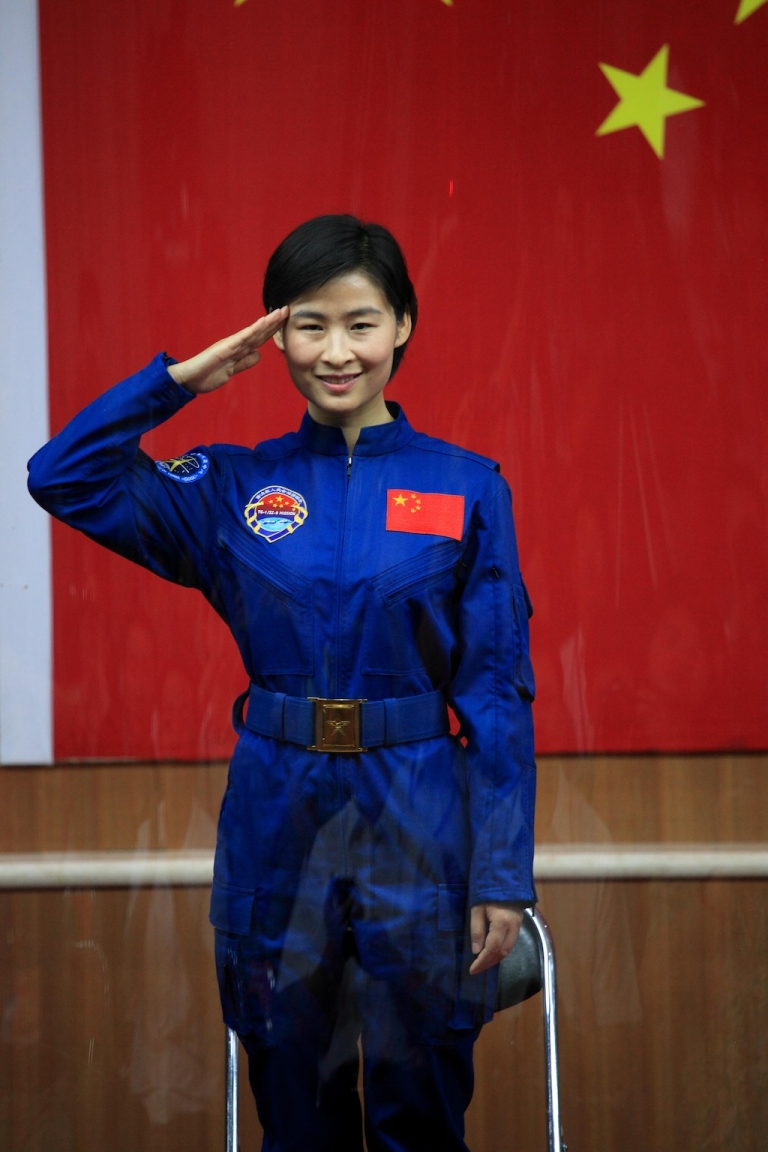 <p>Chinese first woman astronaut Liu Yang salutes as she was introduced during a press conference at the Jiuquan space base, north China's Gansu province on June 15, 2012.</p>
