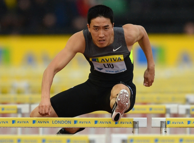 <p>China's Liu Xiang competes in the men's 110m hurdles heat at the Diamond League London Grand Prix on July 13, 2012. Liu pulled out of the final due to muscle pain.</p>