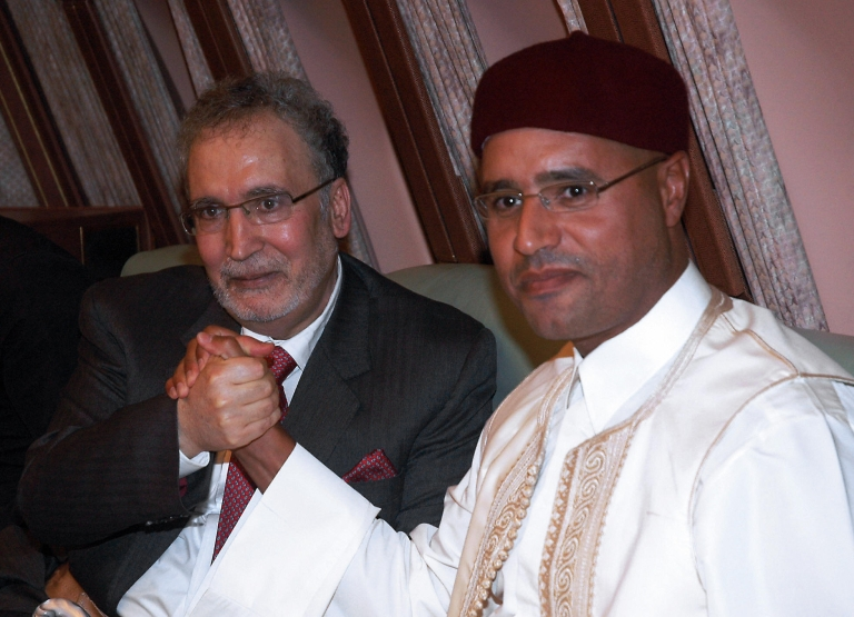 <p>Libyan leader Moamer Kadhafi's son Seif al-Islam (R) holds hands with freed Lockerbie bomber Abdelbaset Ali Mohmet al-Megrahi, the sole Libyan convicted over the 1988 Pan Am jetliner bombing, aboard the Libyan presidential plane that brought him back home in Tripoli late on August 20, 2009.</p>
